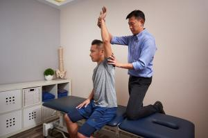 Physiotherapy giving Shoulder Joint Pain Relief and Massage Therapy